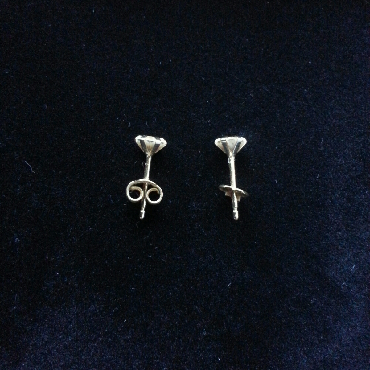 Simple Replacement Earring Backing Above Diamonds And Rubies